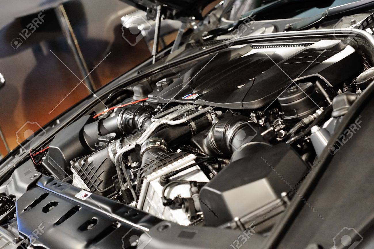 4.4L V8 twin turbo engine of BMW M6 Convertible at its Preview at Singapore Yacht Show April 28, 2012 in Singapore Stock Photo - 13455473