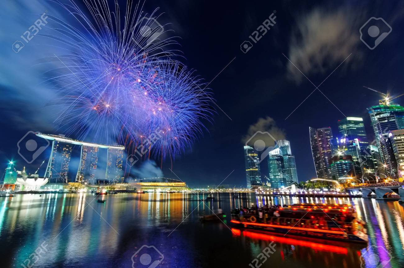 Fireworks over Marina Bay during Singapore National Day Parade 2010 Combined Rehearsal July 17, 2010 in Singapore Stock Photo - 16817346