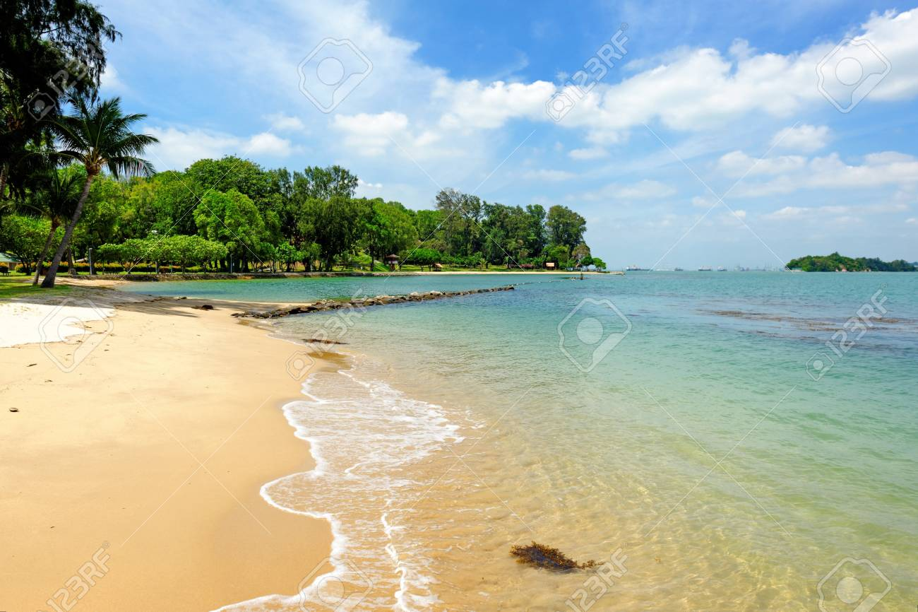 Clear blue sea and tropical sandy beach of St John Island, Singapore