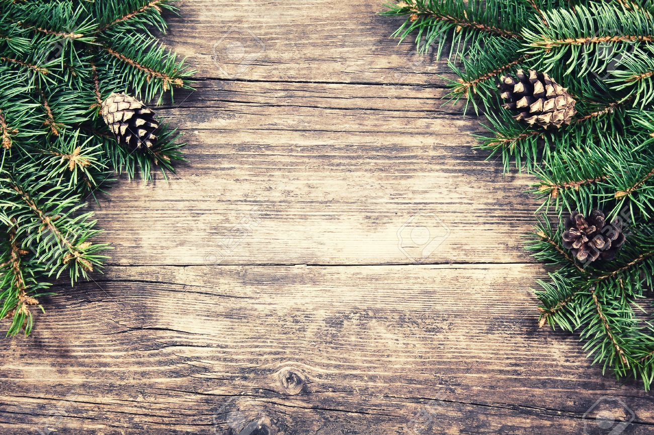 christmas fir tree on a wooden background vintage style - Rustic Christmas Background