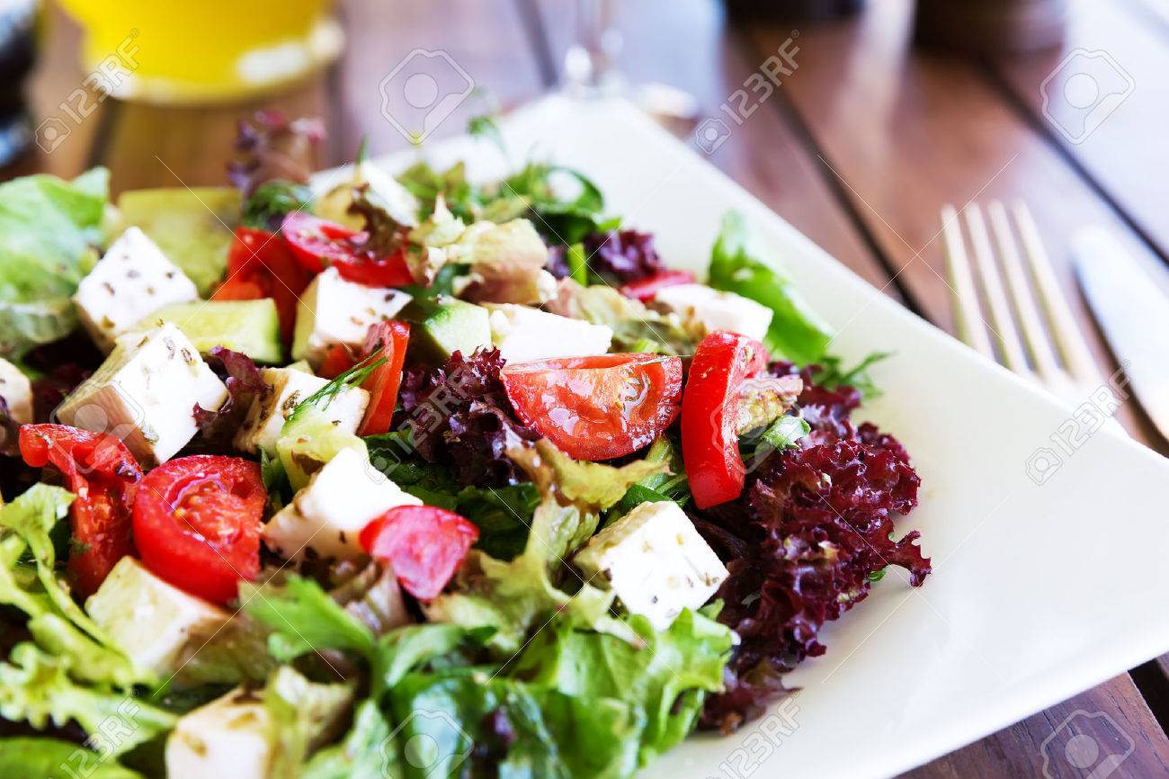 Greek Mediterranean salad with feta cheese, tomatoes and peppers. Mediterranean salad. Mediterranean cuisine. Greek cuisine. - 47187531
