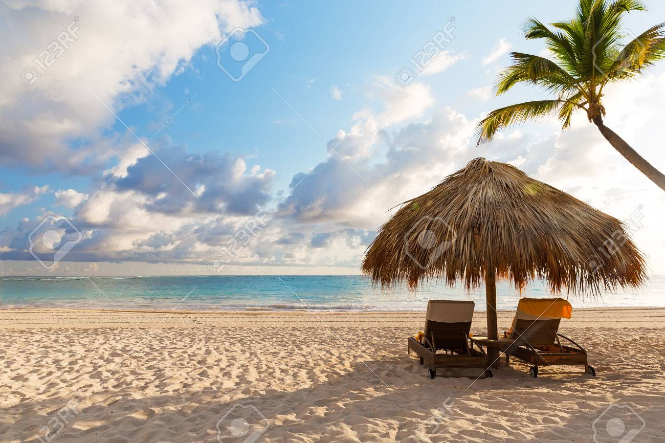 Beach Chairs With Umbrella And Beautiful Sand Beach In Punta Cana,  Dominican Republic Stock Photo