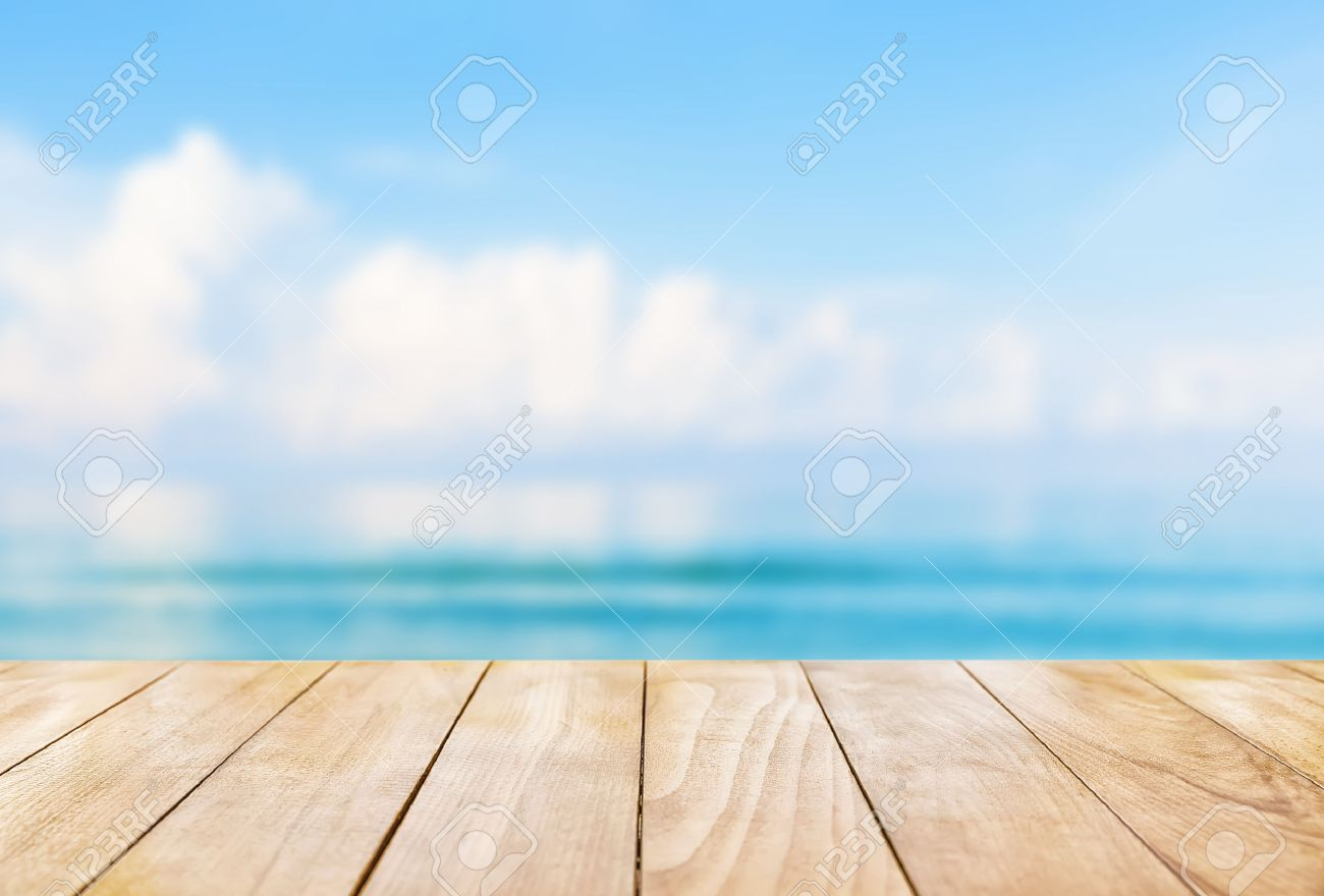 Wooden table top on blue sea and white sand beach background - 58594871