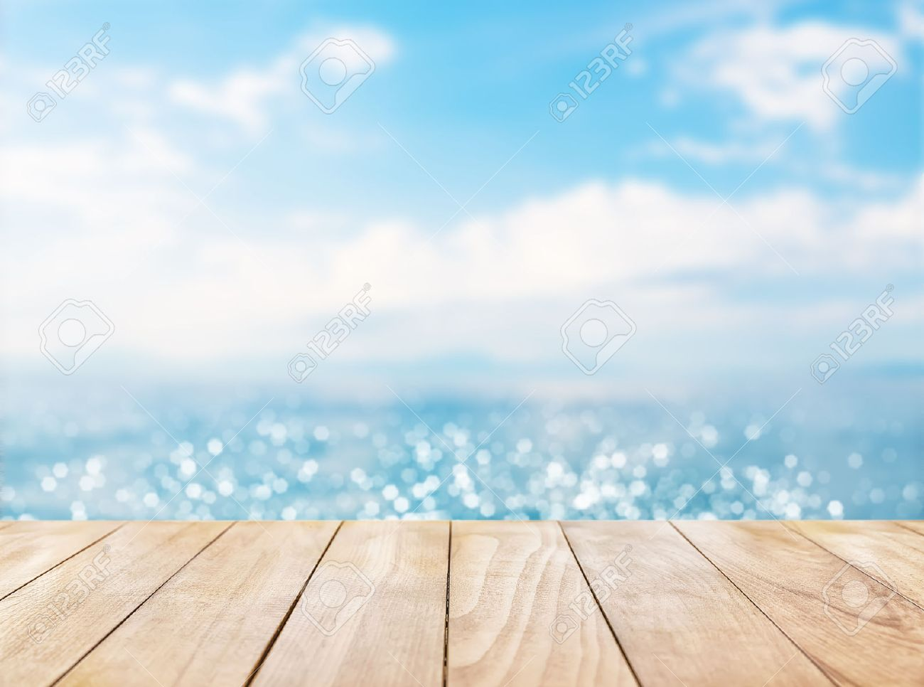Wooden Table Top On Blue Sea And White Sand Beach Background Stock