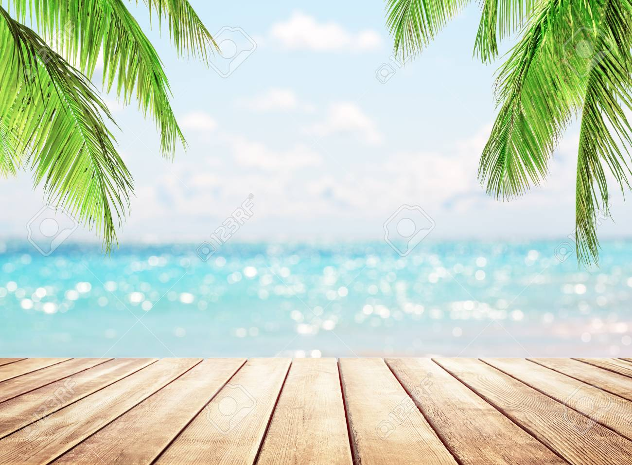 Wooden table top on blue sea and white sand beach background. Coconut palm trees against blue sky and beautiful beach in Punta Cana, Dominican Republic. Vacation holidays background wallpaper. - 125324224