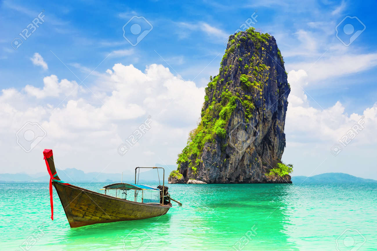 Thai traditional wooden longtail boat and beautiful sand beach at Koh Poda island in Krabi province. Ao Nang, Thailand. - 150527550