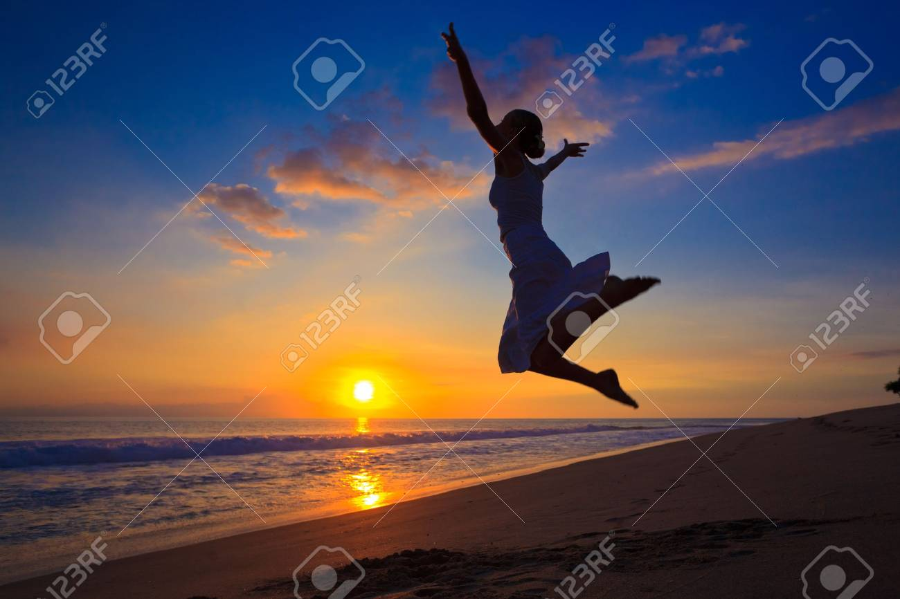 Young girl jumping in the sunset Stock Photo - 7601512
