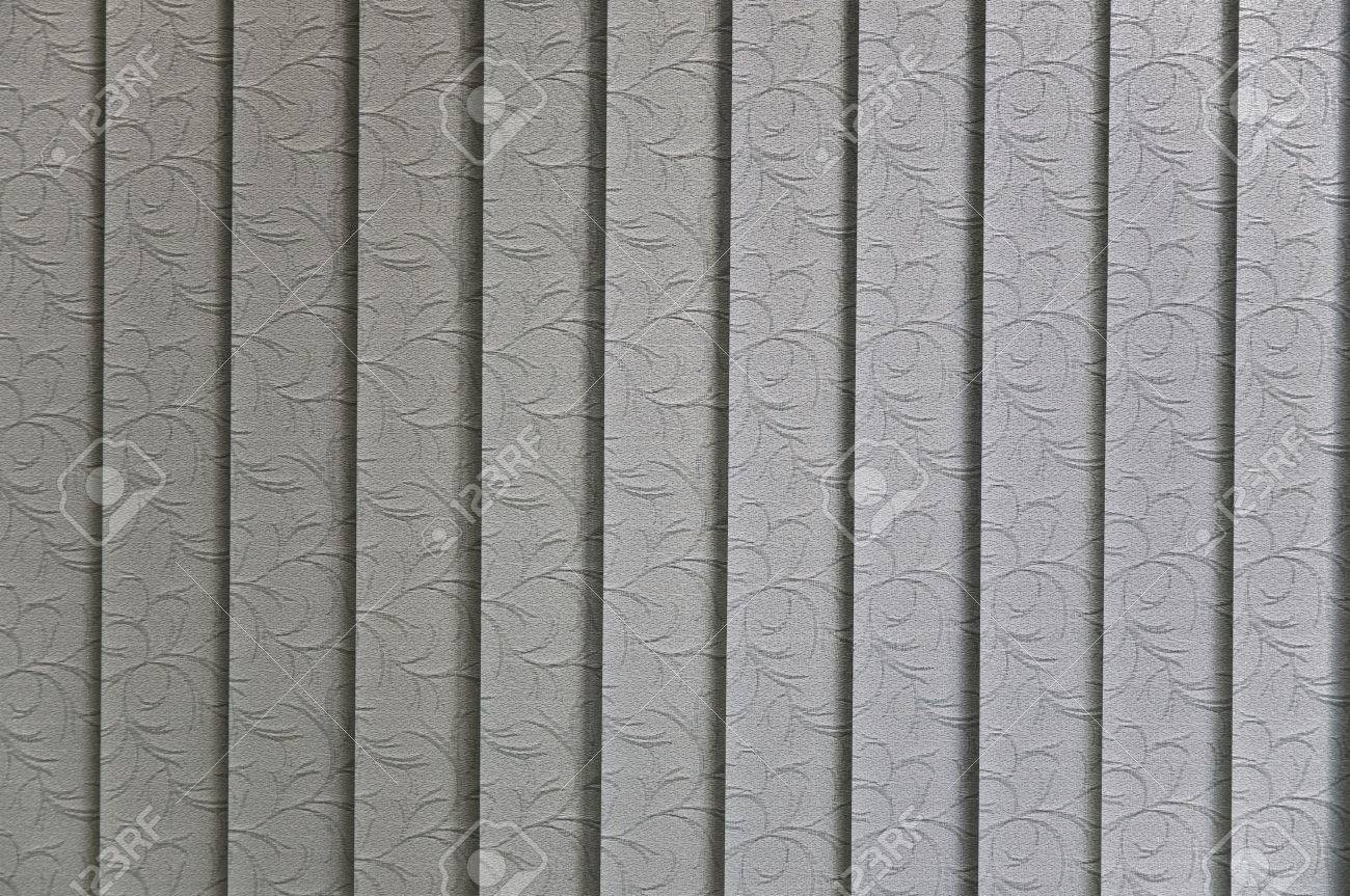 Vertical blinds textile pattern sun lit from behind - 5372428