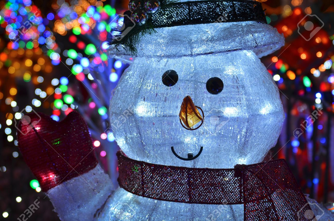 Christmas concept with outdoor snowman lights at night stock photo christmas concept with outdoor snowman lights at night stock photo 11596560 mozeypictures Image collections