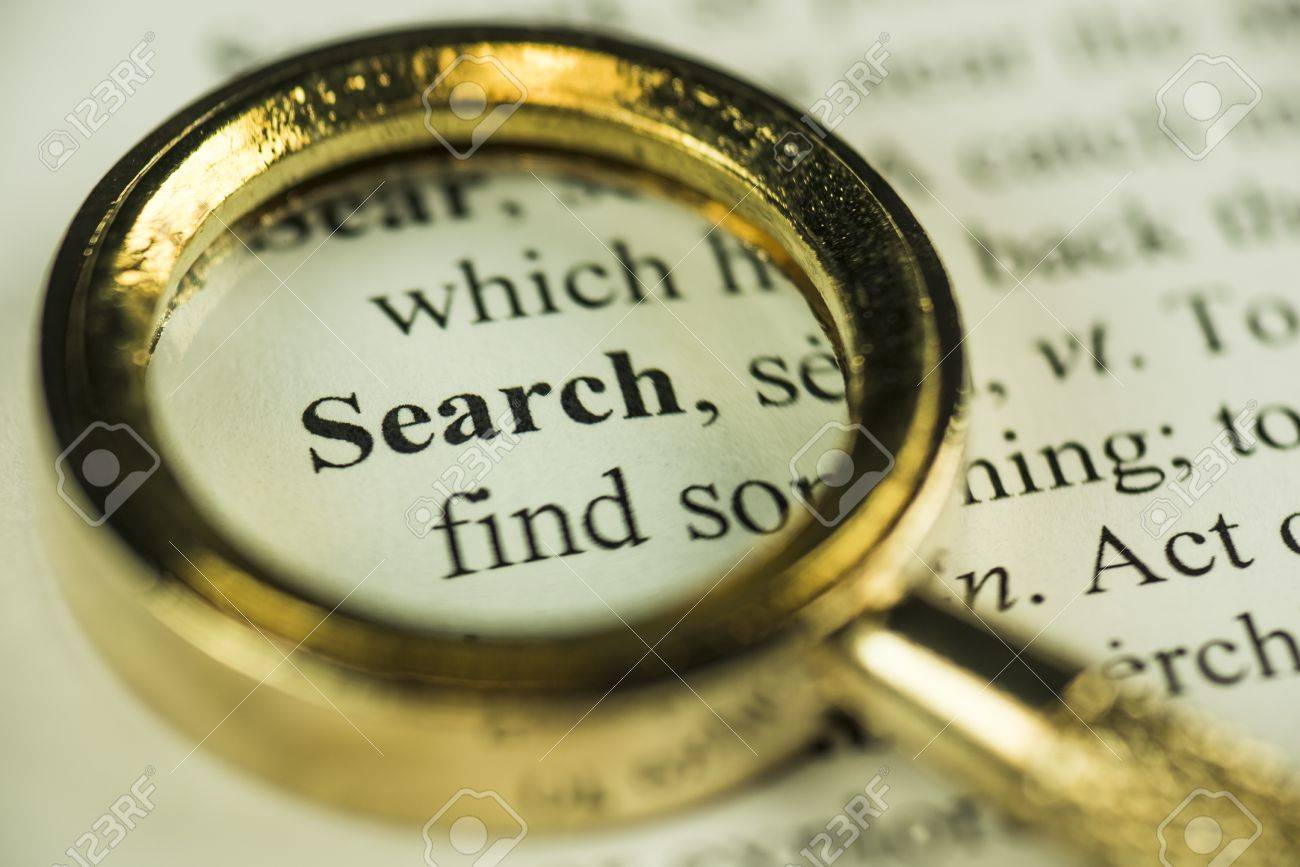 Macro Image Of A Magnifying Glass Over The Search Word In A Dictionary - 24590873