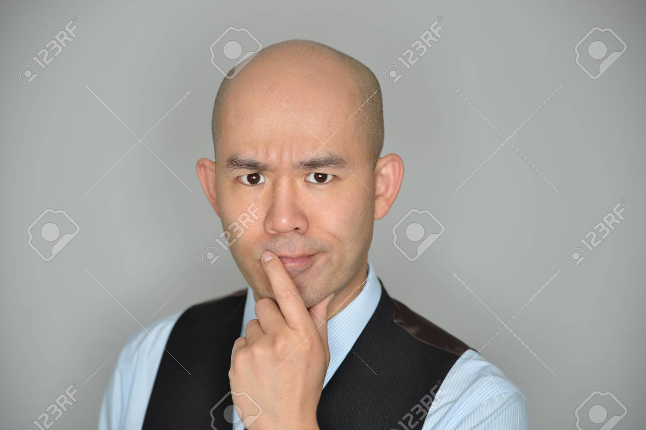 Businessman Confused and Perplexed Expression Isolated on Grey - 106385112