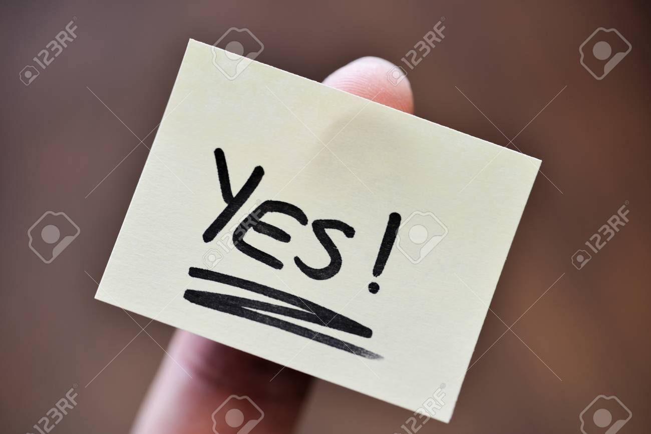 Success / Goal Concept - Index Finger Holding Note With Handwritten YES Word - 106385135