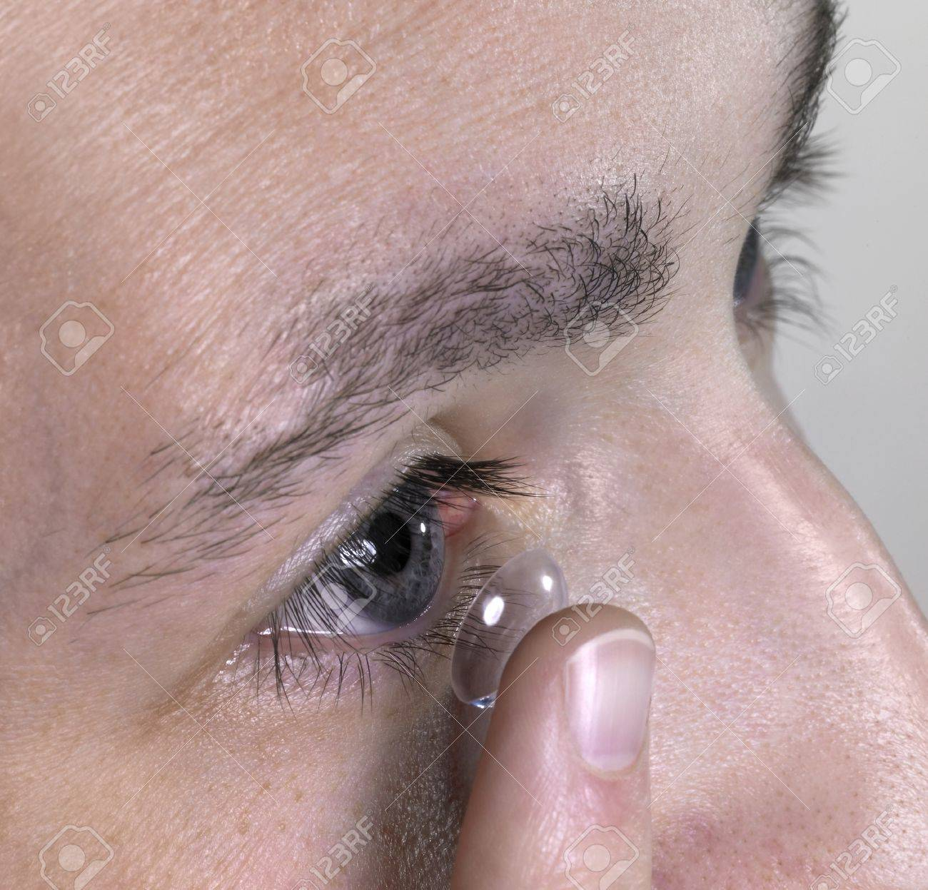 detail of a eye while placing a contact lens Stock Photo - 10839855