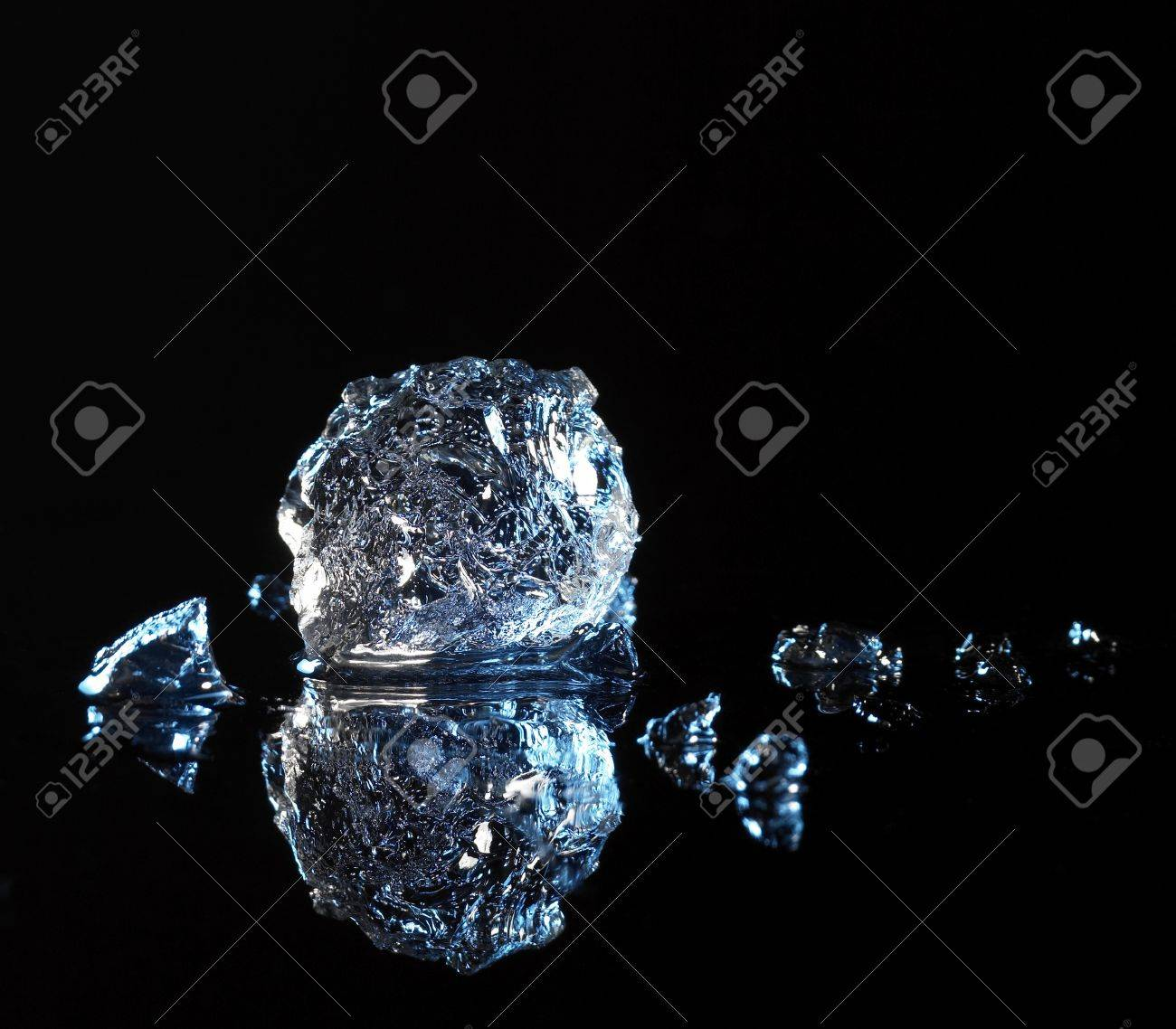 studio photography of a ice crystal and smoke in black reflective back Stock Photo - 10839881