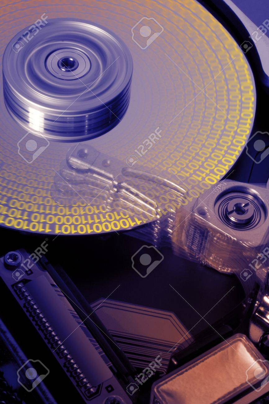 studio photography of a opened hard disk at work with symbolic data while processing Stock Photo - 10862523