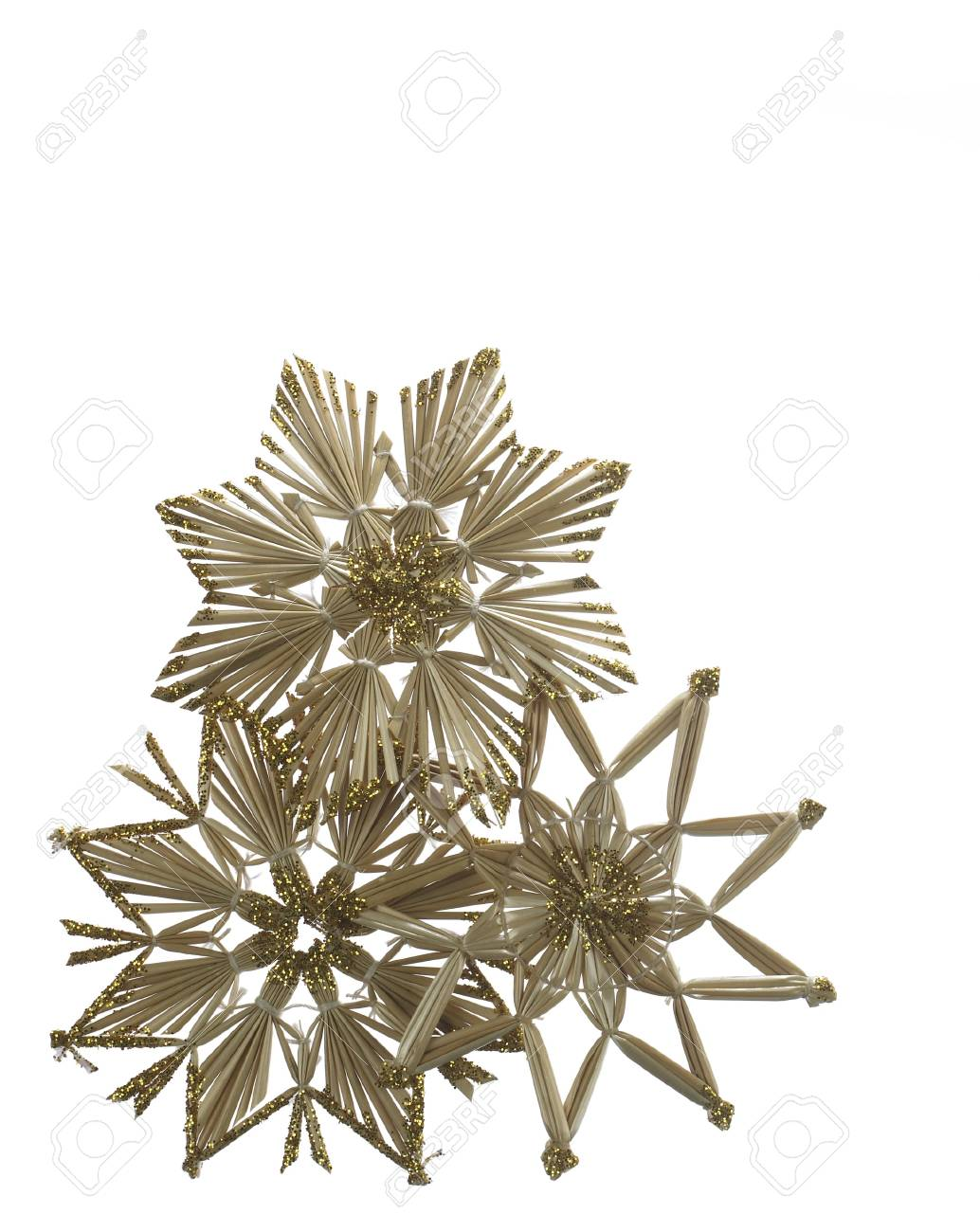 Studio photography of some straw stars isolated on white Stock Photo - 10913584