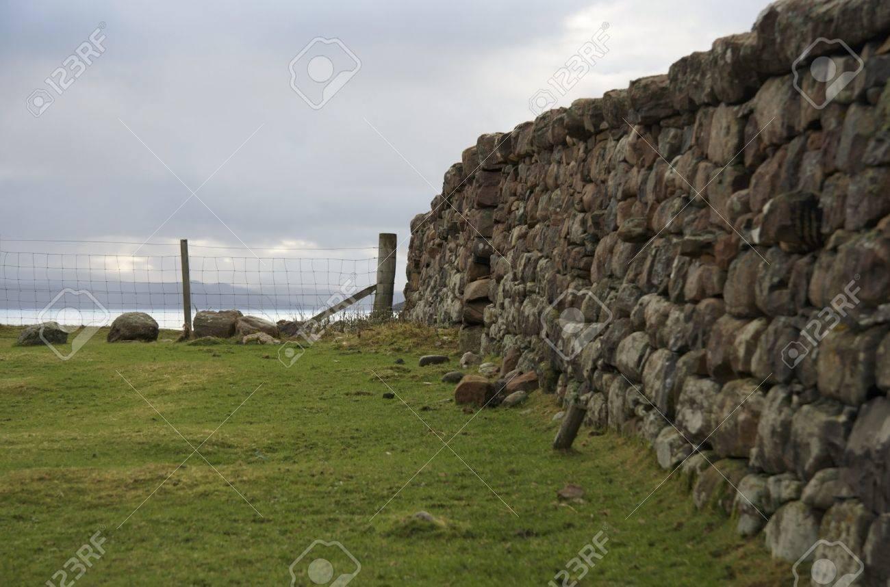 cloudy scenery in Scotlandwith stone wall Stock Photo - 10968449