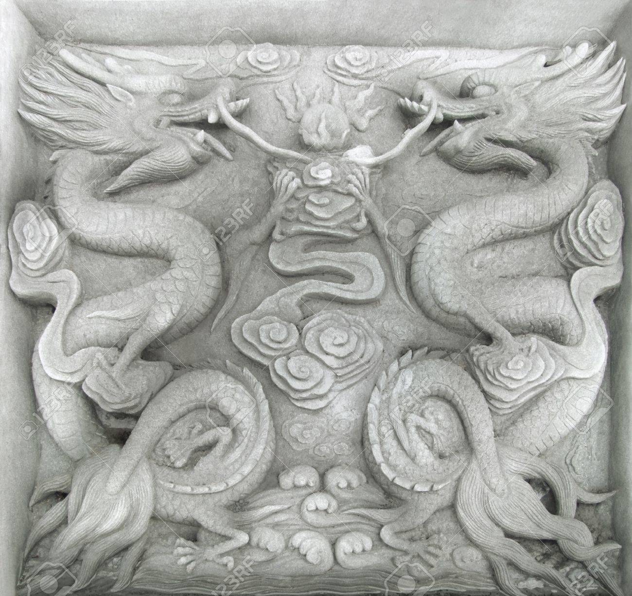 stone relief in a historic district named Fengdu County a necropolis in China built over 1800 years ago. The relief is showing two fire-drakes Stock Photo - 10965468
