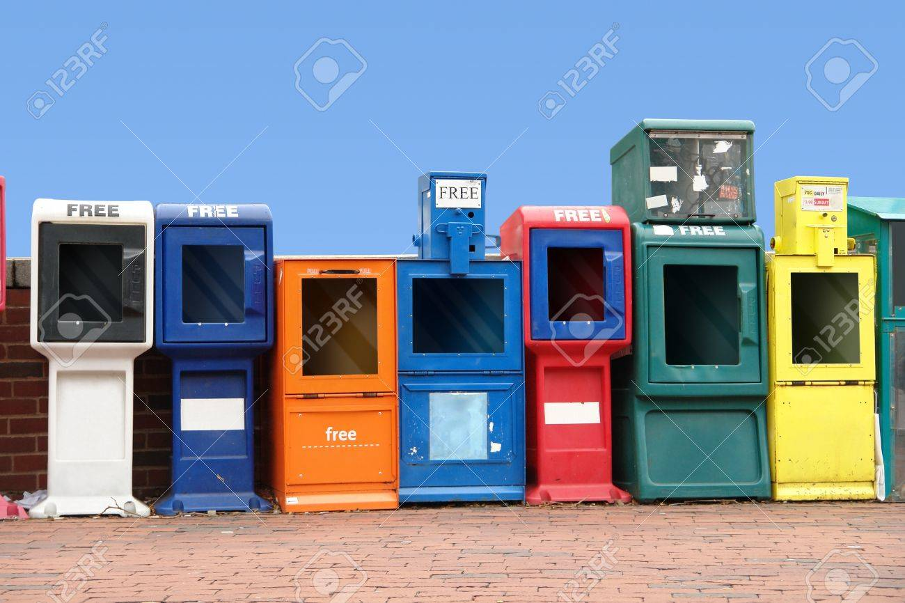 symbolic picture showing some colorful news racks standing in a row at the Harvard Square in Cambridge Massachusetts, USA) Stock Photo - 10986119