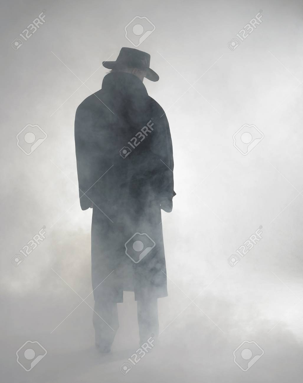 woman with dark coat standing in the fog Stock Photo - 10987214