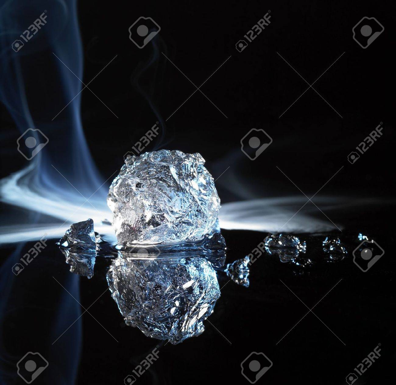 studio photography of a ice crystal and smoke in black reflective back Stock Photo - 11014519