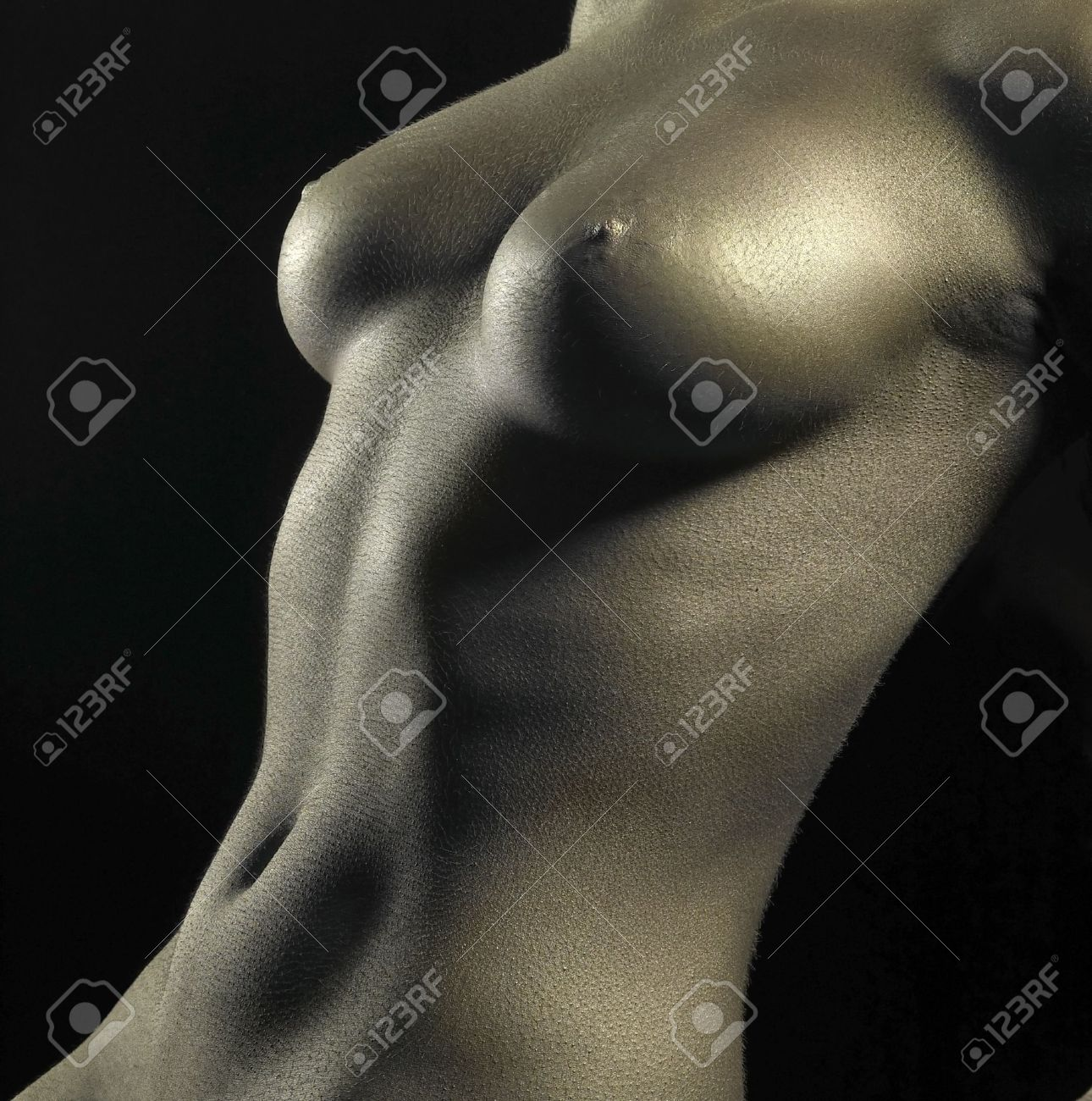 studio photography of a naked female body detail bodypainted with golden color in black back Stock Photo - 11340860