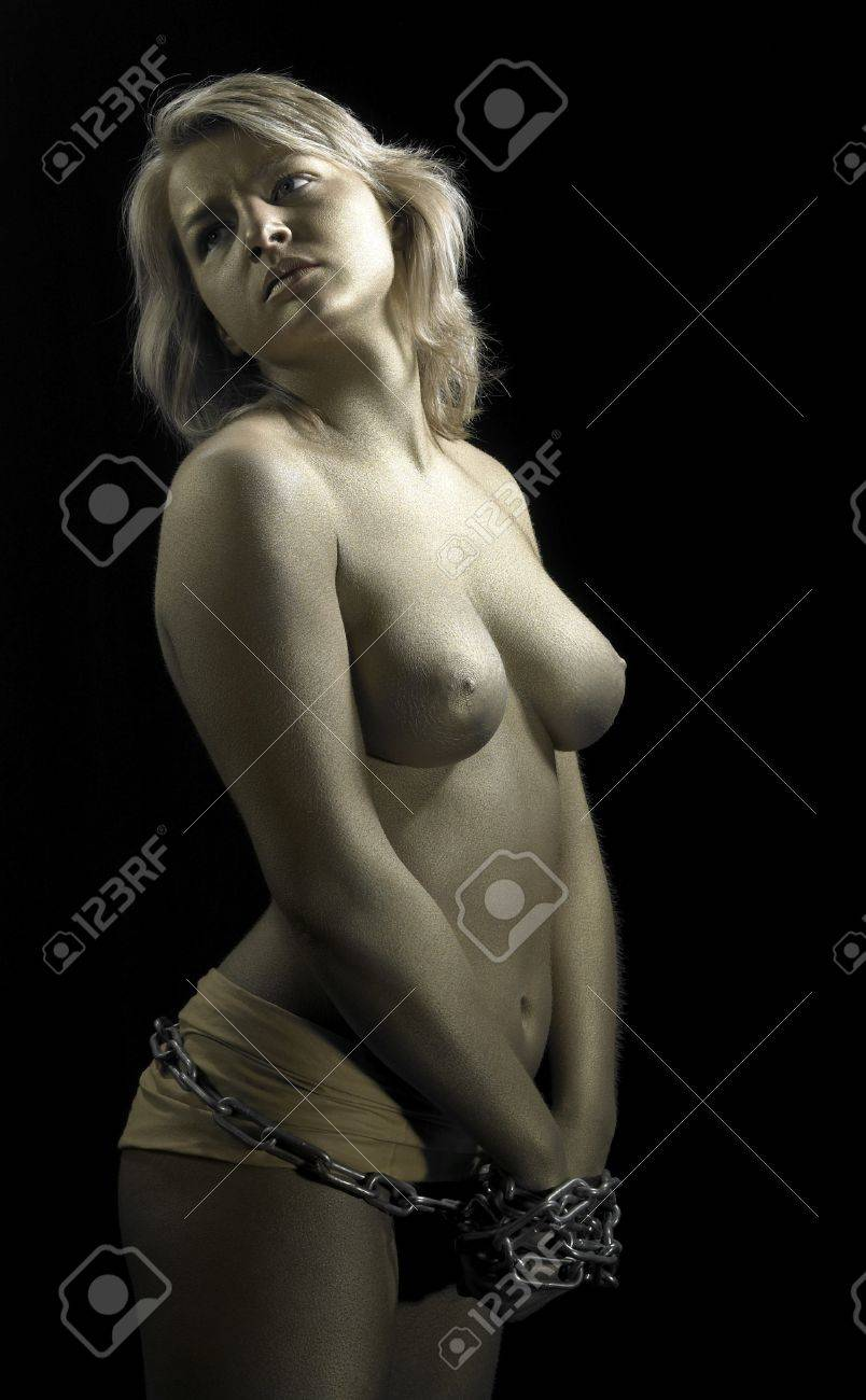 studio photography of a golden bodypainted girl in chains Stock Photo - 11332422