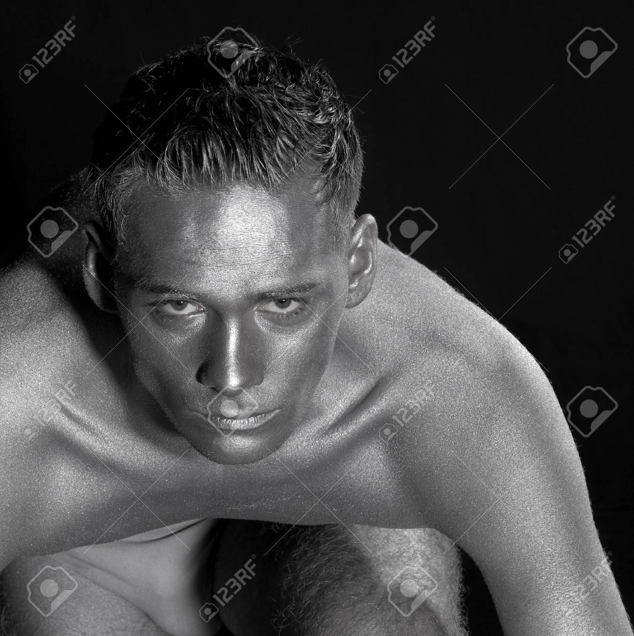 silver bodypainted portrait of a concentrated young man.Studio shot in black back Stock Photo - 11402882