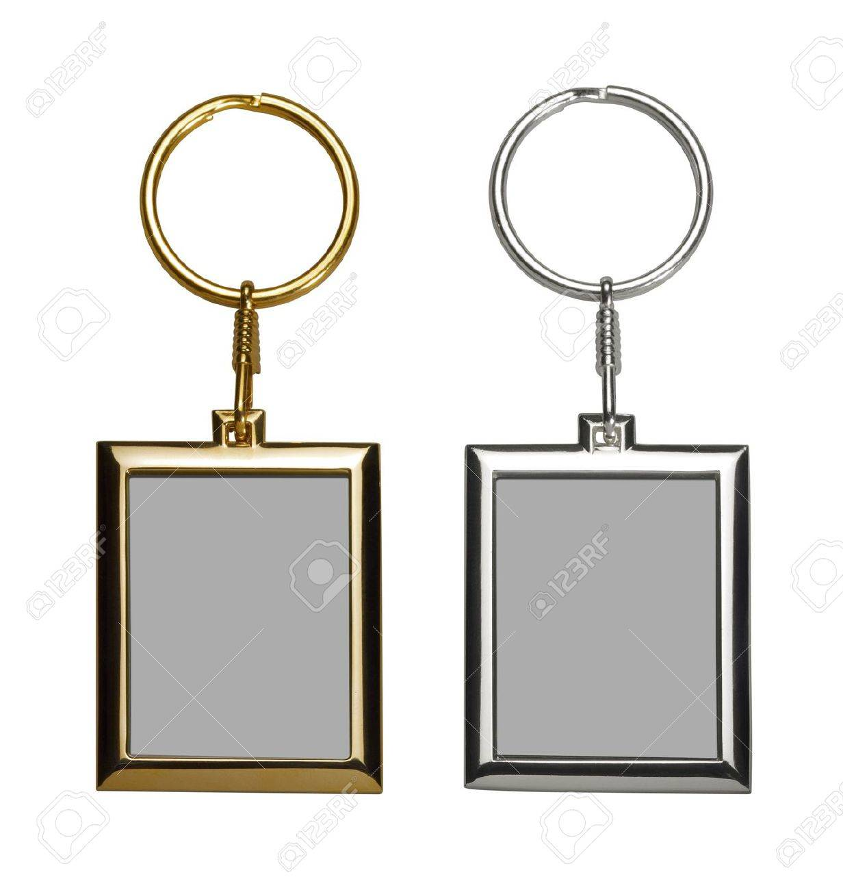 two gold and silver colored keychains with picture frame Stock Photo - 17587336