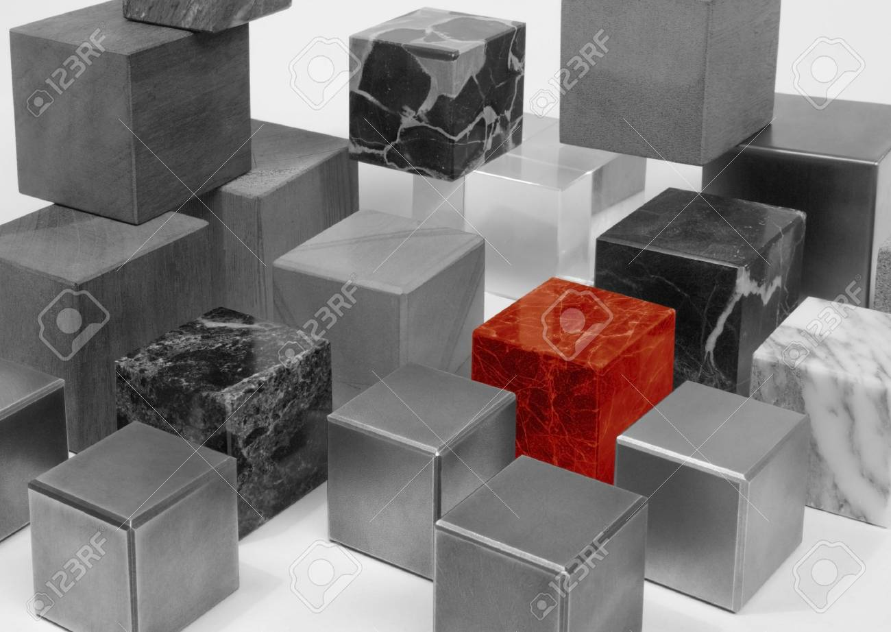 various cubes made of different materials, black and white toned including a outstanding red one Stock Photo - 18416583