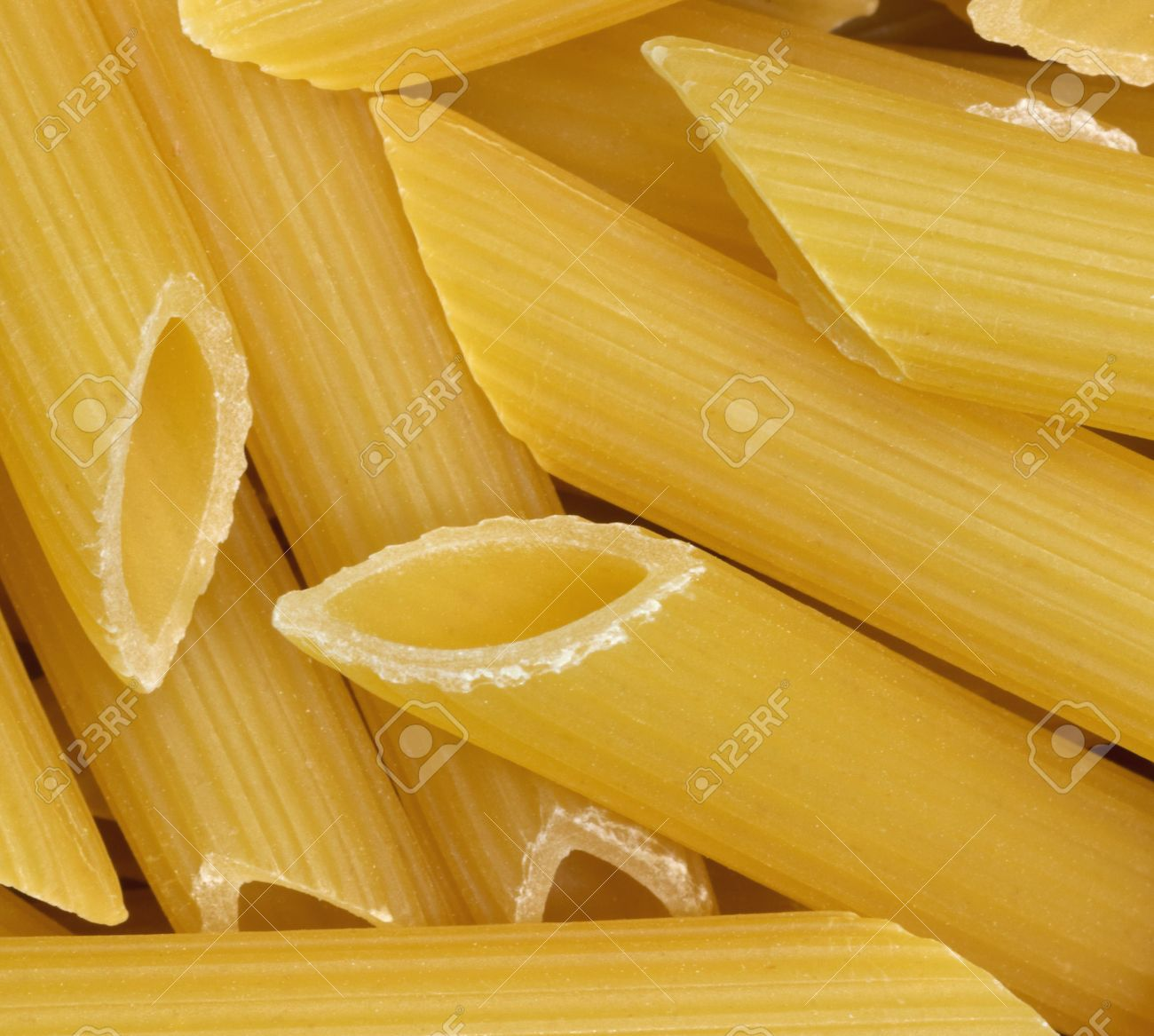 Full frame background with lots of italian rigatoni noodles stock full frame background with lots of italian rigatoni noodles stock photo 25234741 jeuxipadfo Choice Image