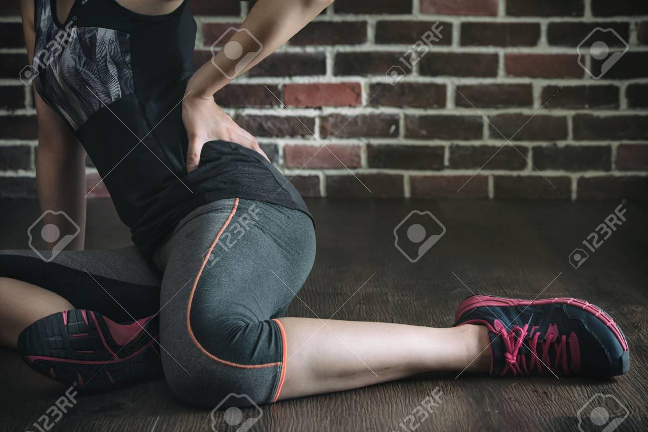 pushing her body too far got low back pain in fitness exercise