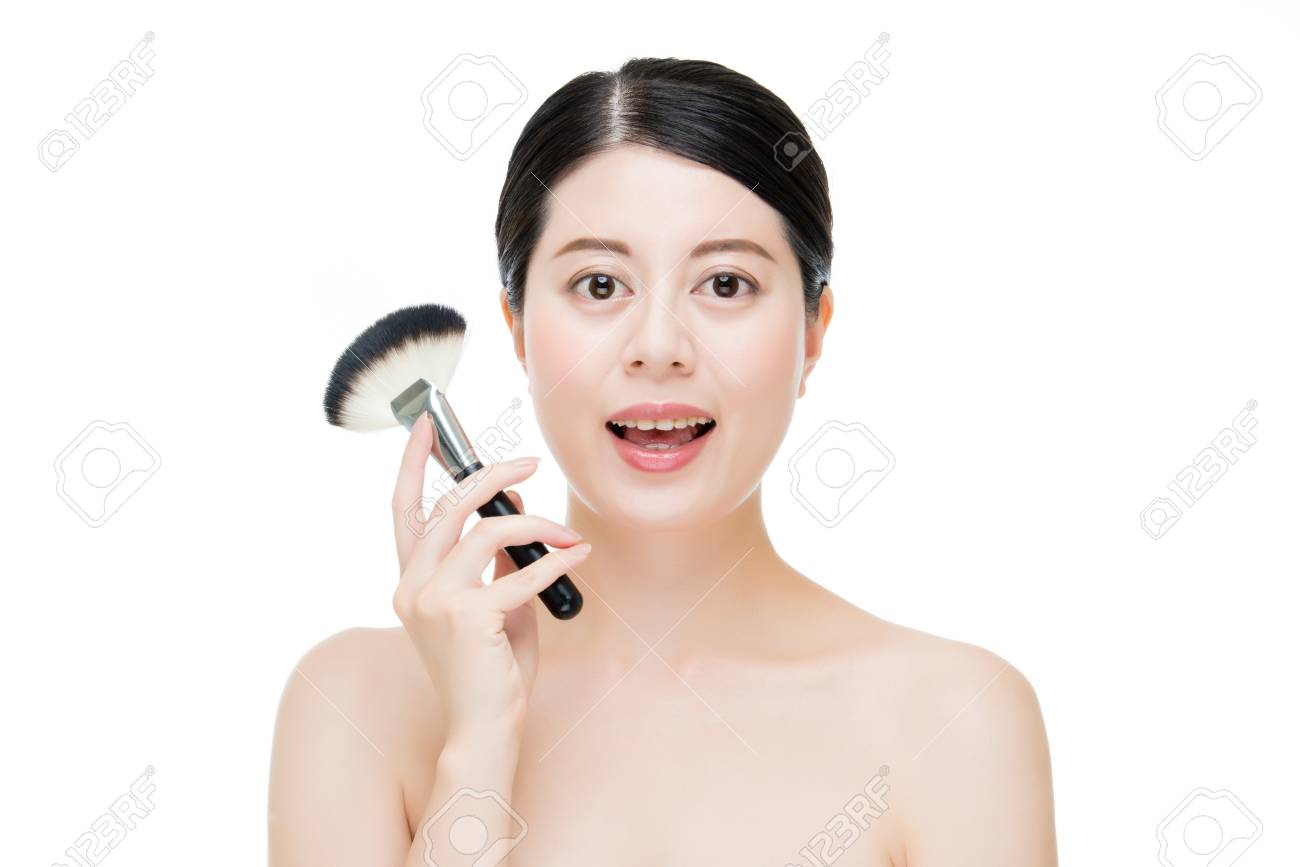 Apply Makeup Foundation With Brush On Young And Beautiful Asian Stock Photo Picture And Royalty Free Image Image 65704097