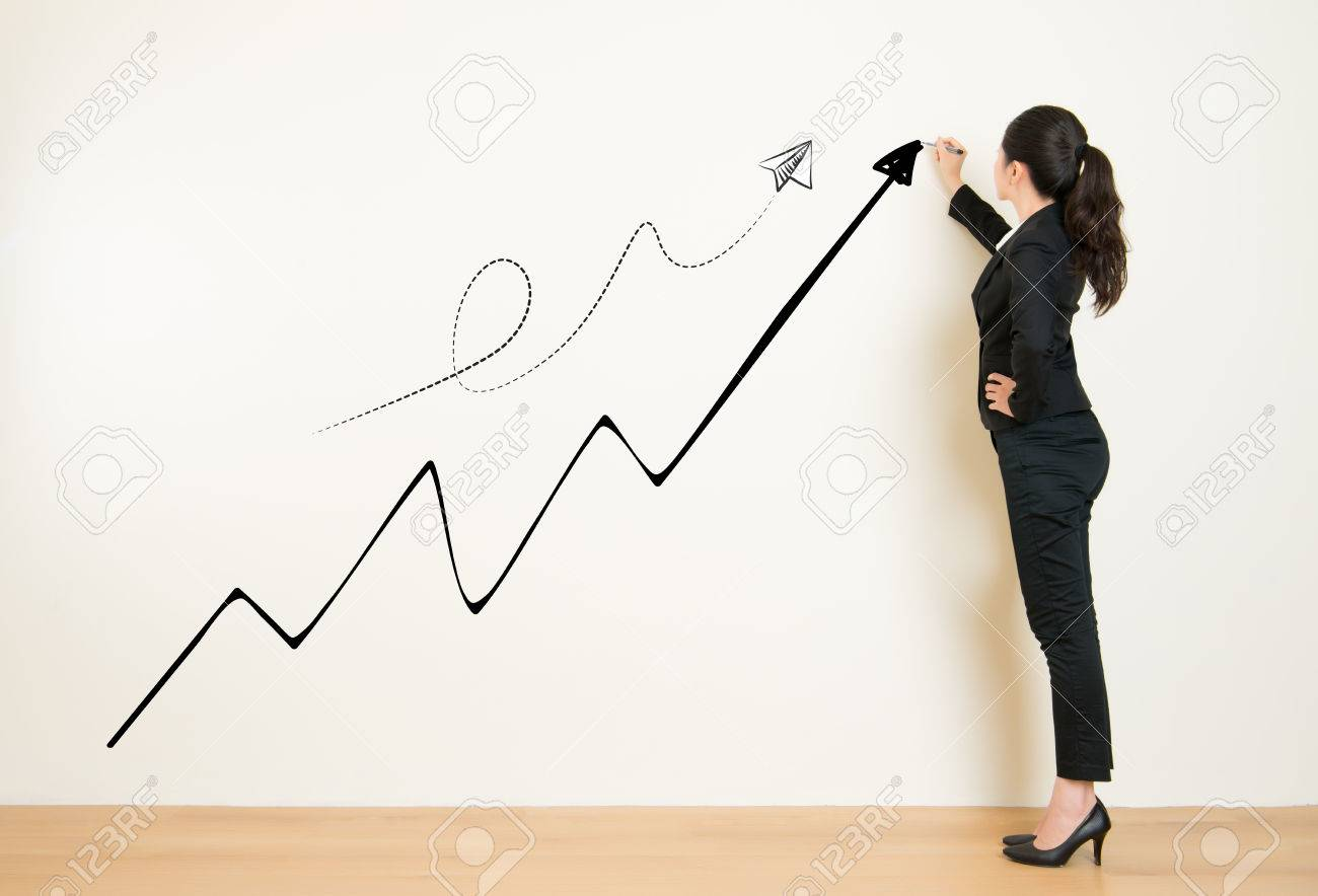 Business success growth chart business woman drawing graph showing business success growth chart business woman drawing graph showing profit growth on white wall nvjuhfo Choice Image