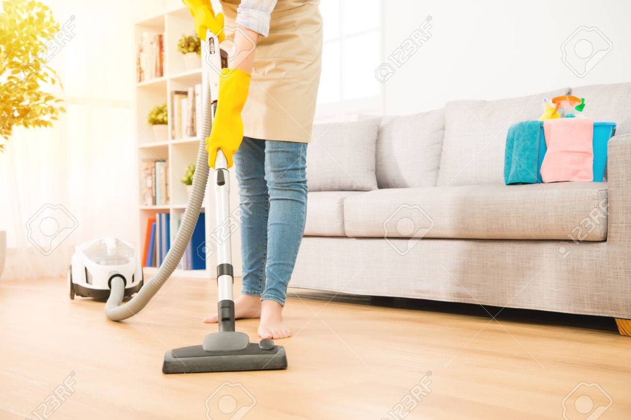 Woman Use Vacuum Cleaner To Cleaning The Floor In Living Room. Housework  Concept. Mixed