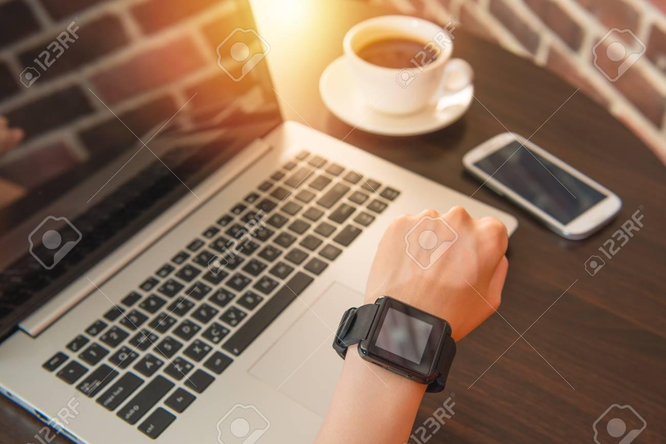 d38da4e984e Stock Photo - woman using smart watch in coffee shop