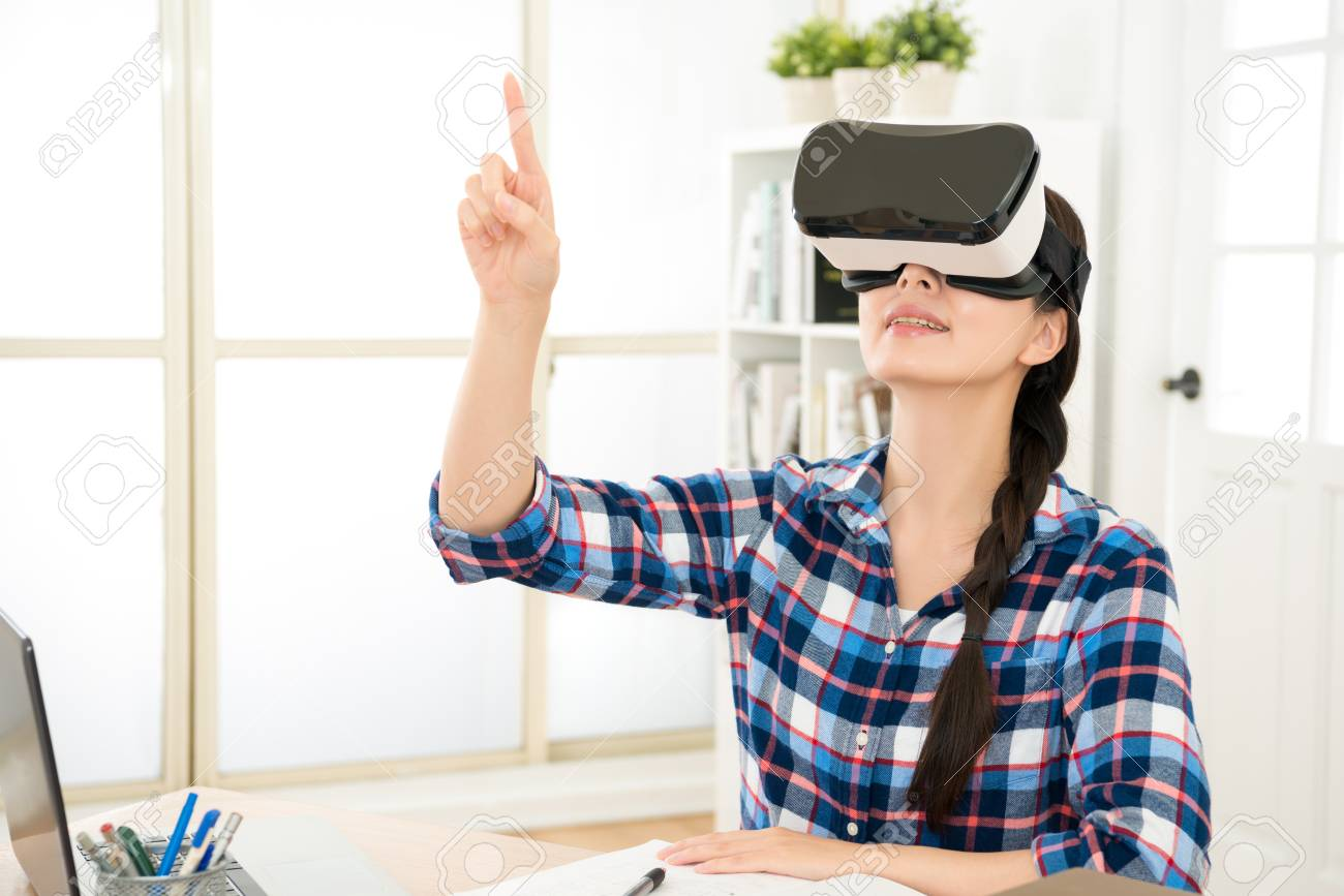 mixed race asian chinese model excited using a VR headset and