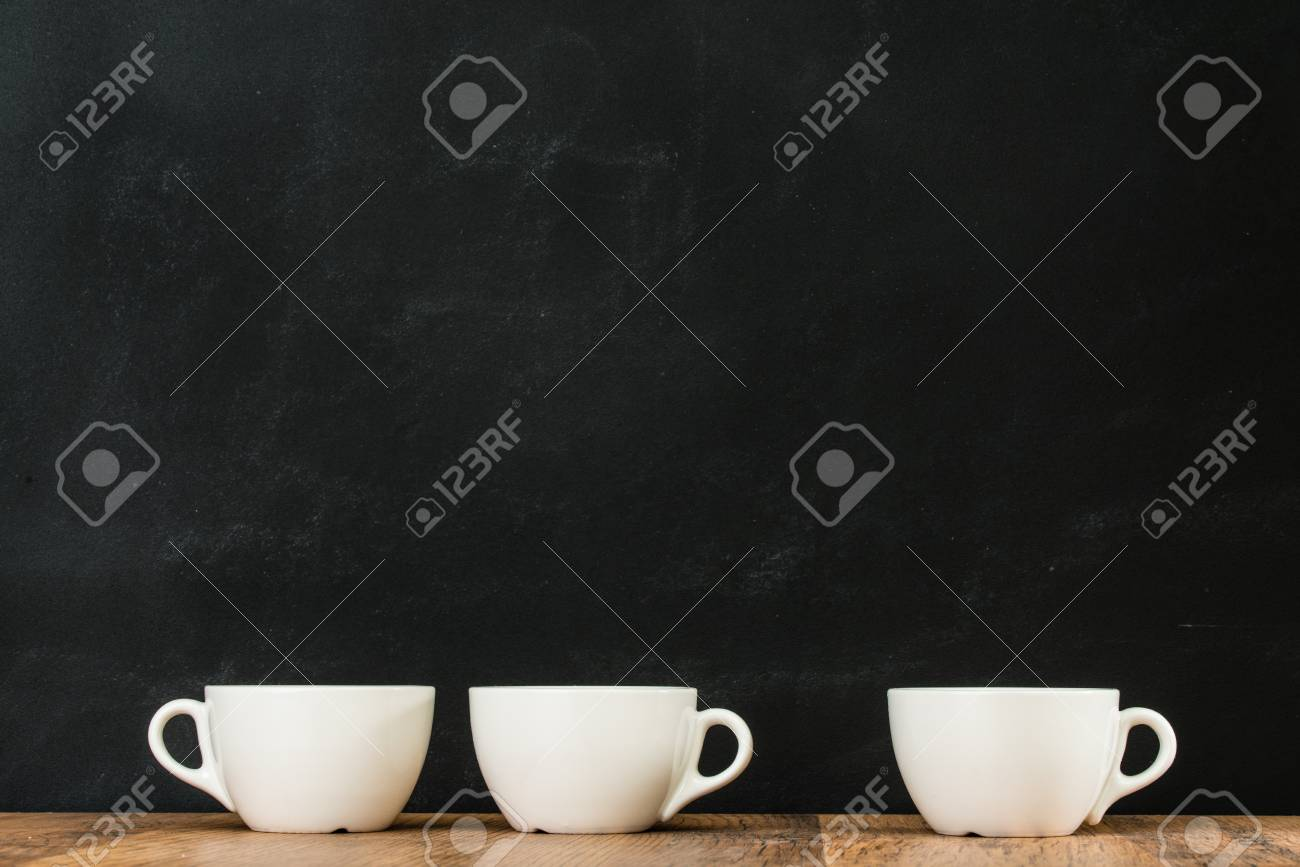 Ceramic White Coffee Cups Grouped On Wooden Floor Texture With Stock Photo Picture And Royalty Free Image Image 83772573