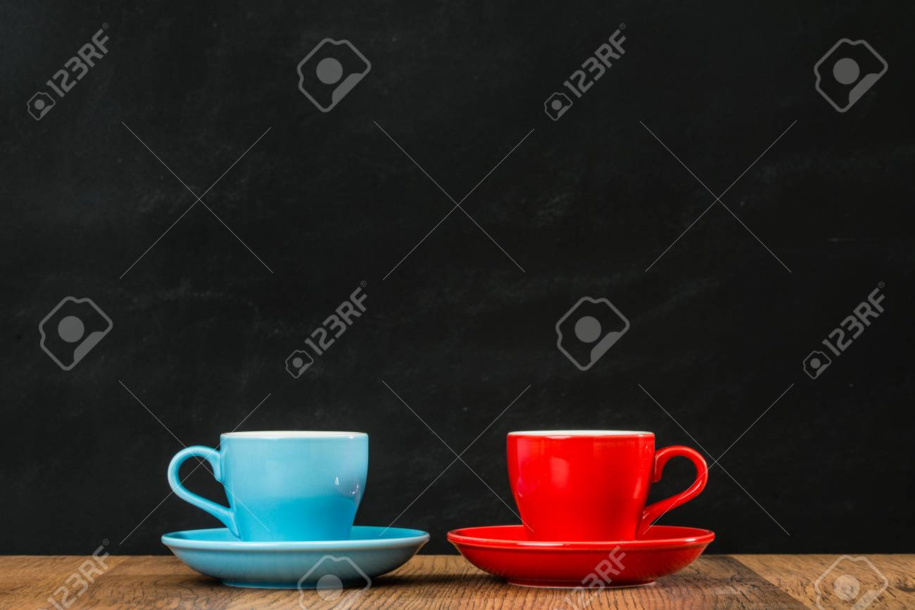 Ceramic Coffee Cups Leaning Together On Wood Texture Table With Stock Photo Picture And Royalty Free Image Image 83772531