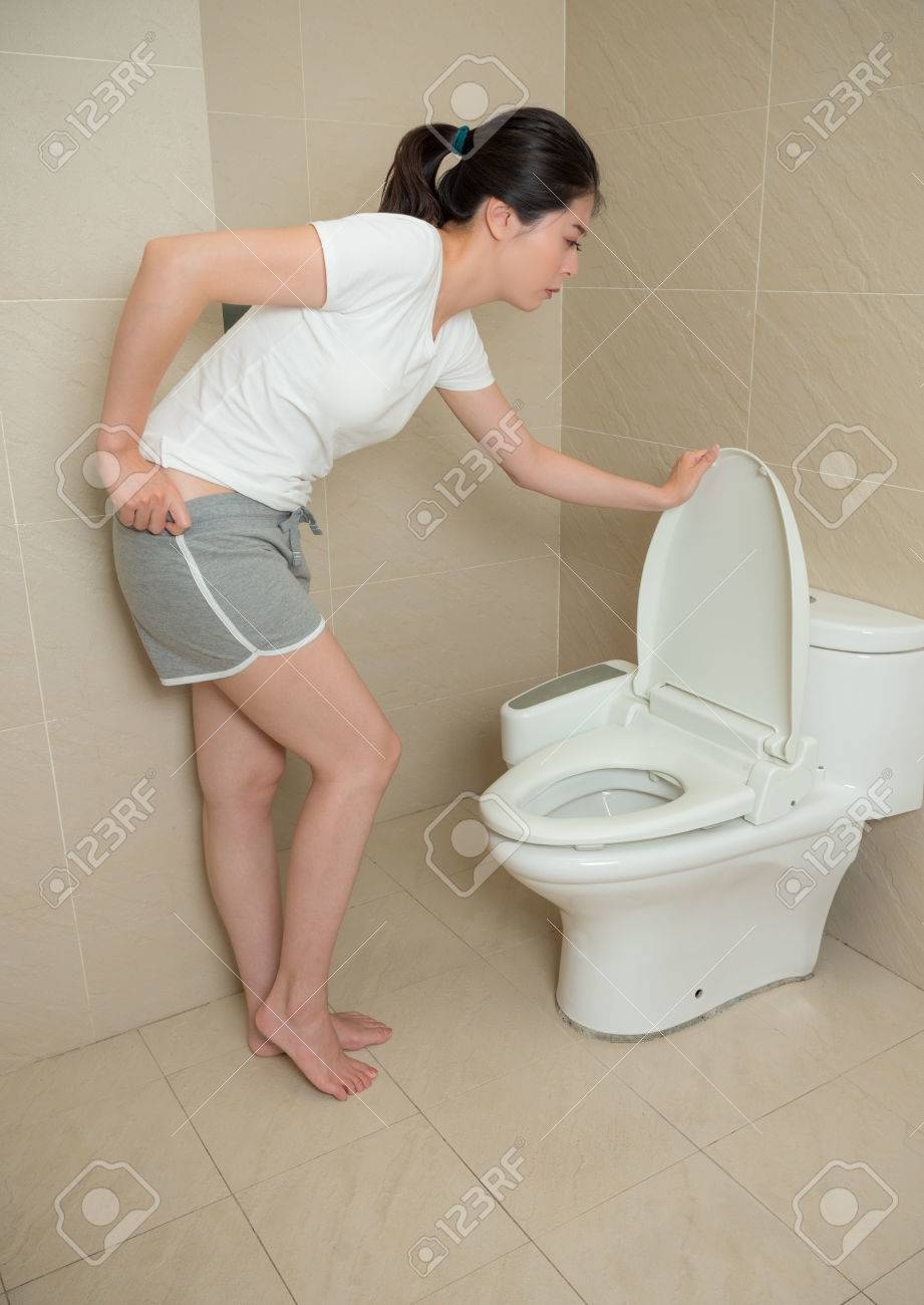 Pretty Lovely Woman Opening Toilet Lid And Holding Pant Want To Diarrhea When She Eating Bad