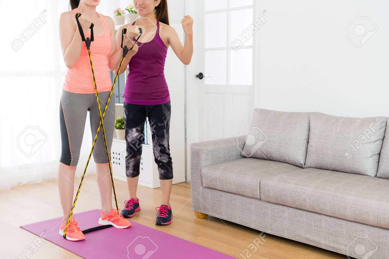 Pretty Attractive Female Home Fitness Tutor With Student Using ...