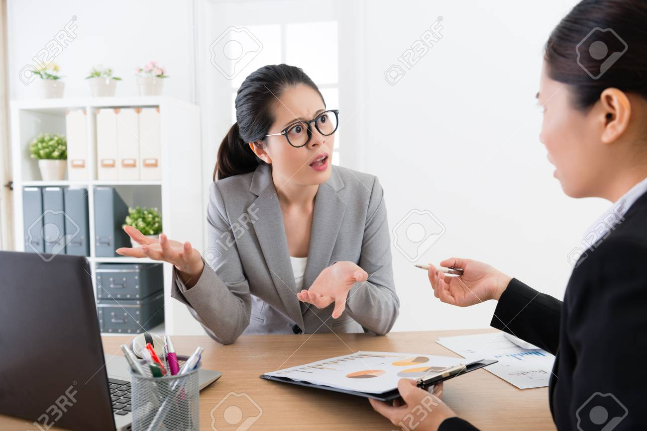 Asian female boss confuse with diagram project and asking the employee  blaming office lady workshit with