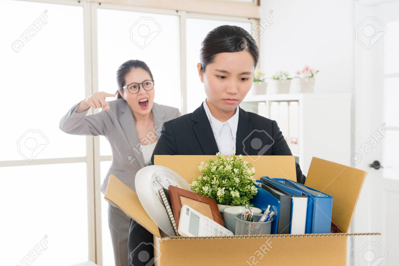 Asian employee scolded by the mean boss shouted and yelled to