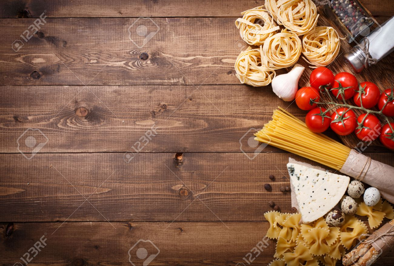 Overhead View Of Ingredients For An Italian Pasta Recipe On Rustic Wood Background Stock Photo