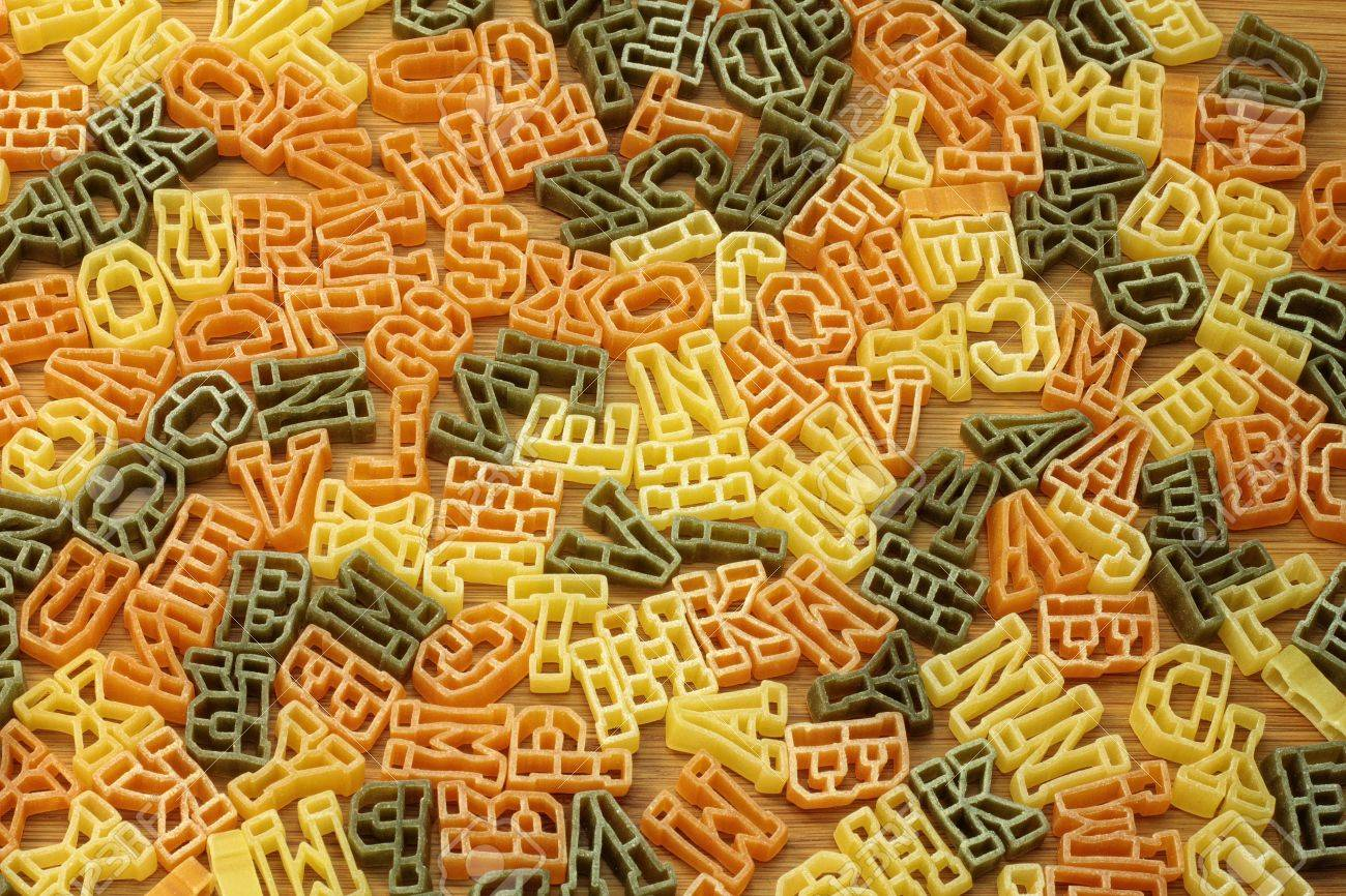 Pasta in shape of letters for background. Stock Photo - 12325408