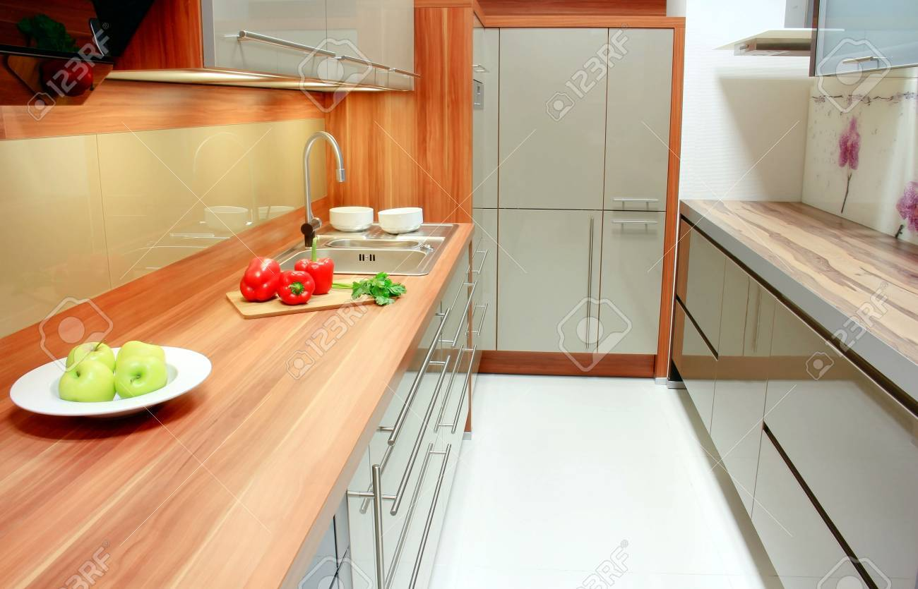 New kitchen interior; green apple, red pepper and parsley in the kitchen Stock Photo - 13767794