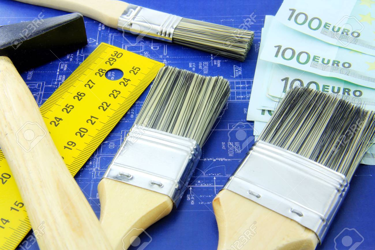 Renovating a home concept; hammer, meter, brushes and money on blue print Stock Photo - 12909063