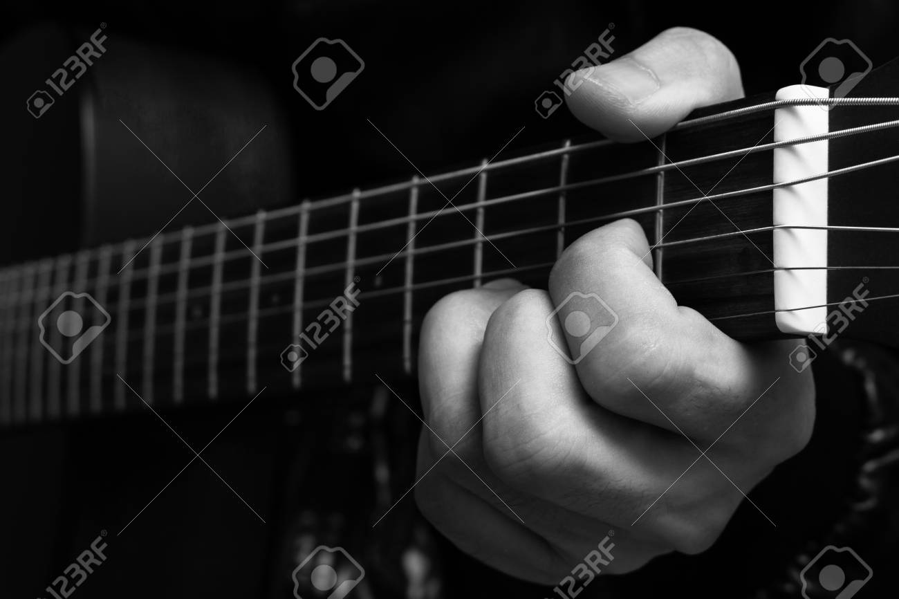 Musician Left Hands Playing Chord On Guitar Fingerboard Bw Filter