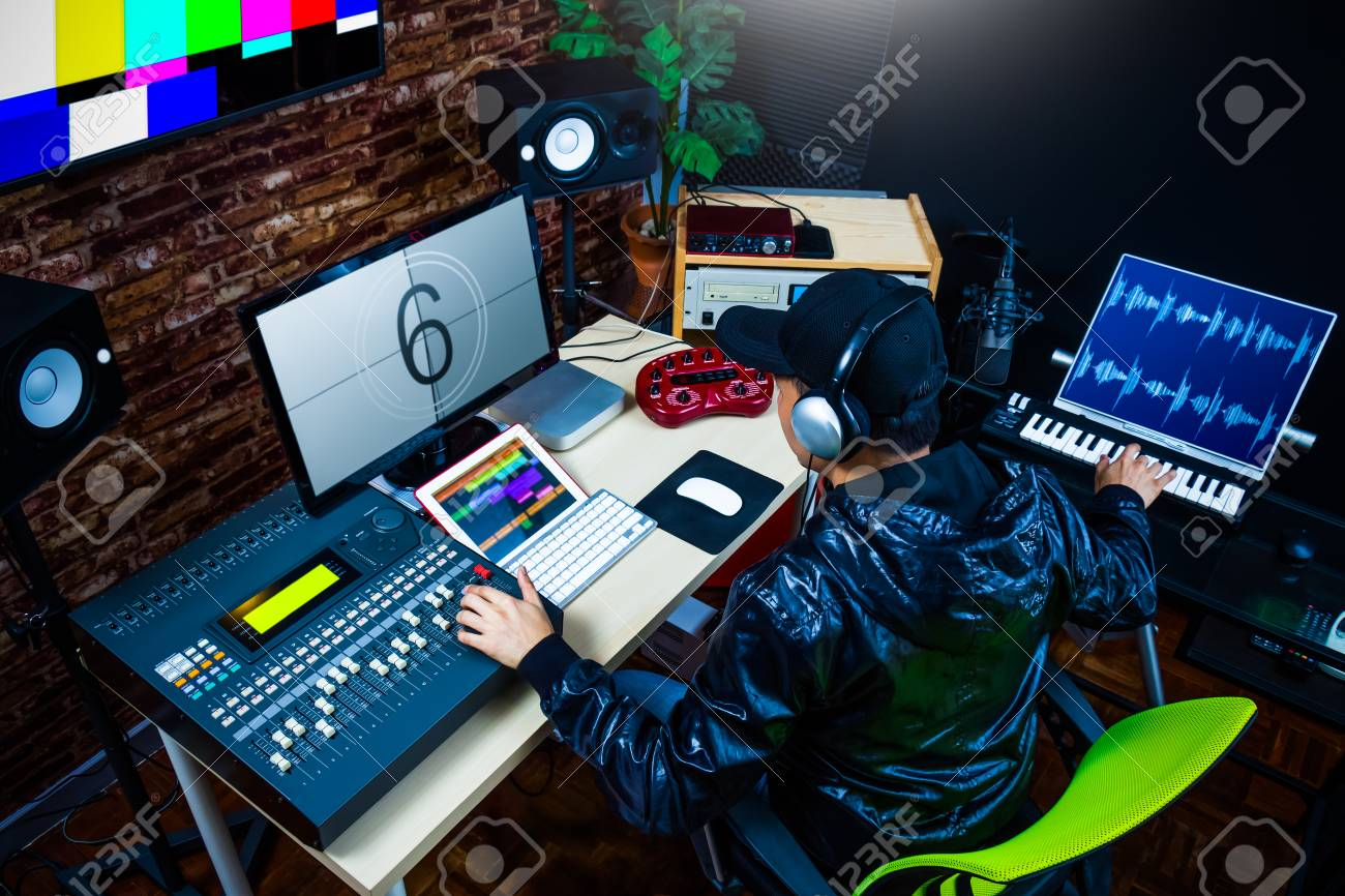 asian male sound engineer working in digital audio & video editing