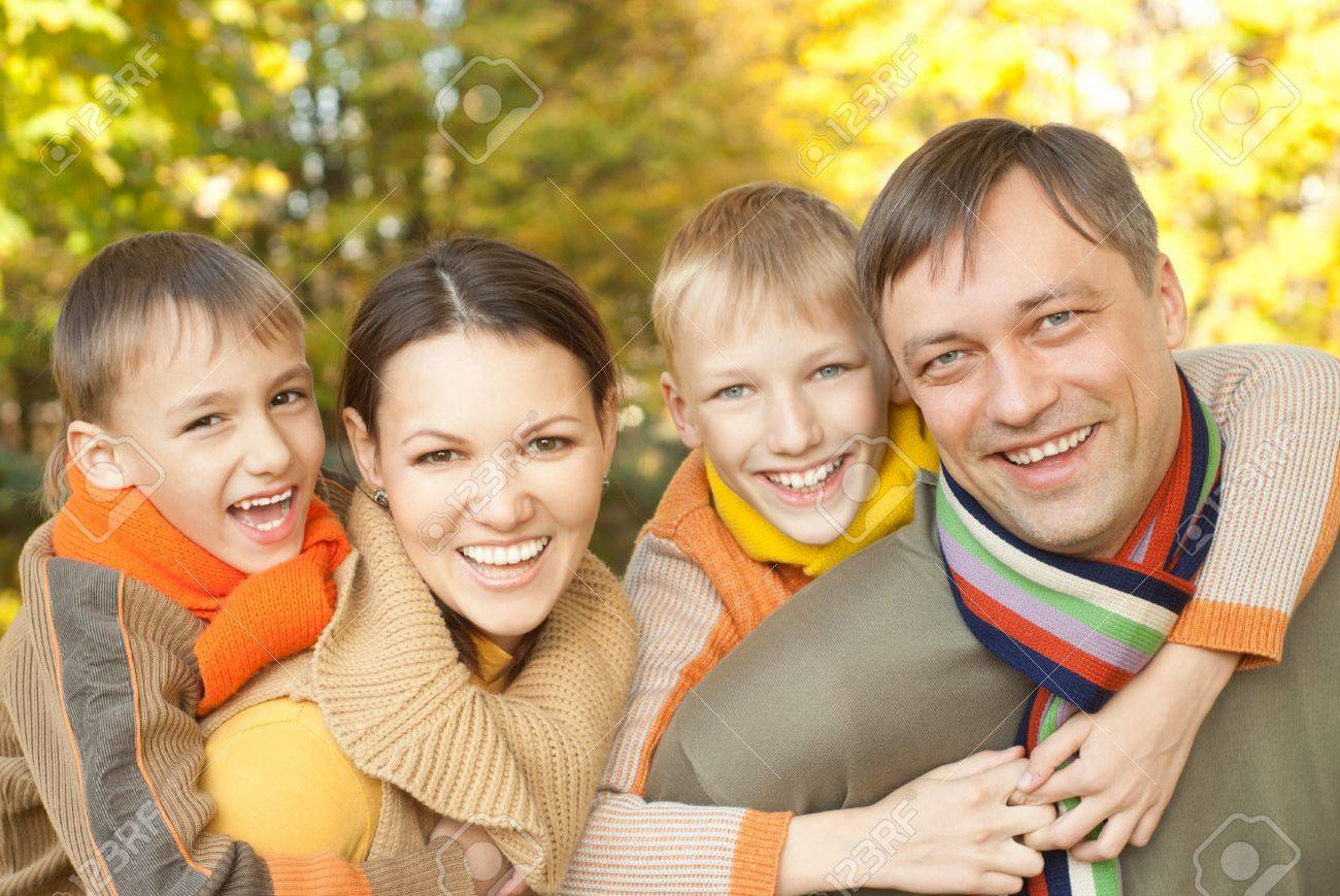 Living Room Family Of Four Picture Ideas happy family of four on the nature stock photo picture and nature
